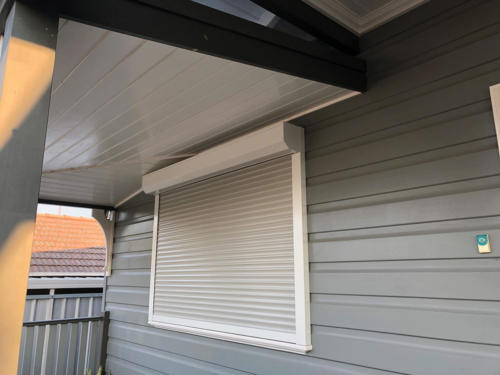 White on wall shutter with shale grey curtain